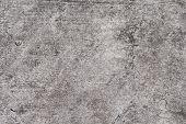 Grunge concrete texture. Grey asphalt road top view photo. Distressed and obsolete background texture. Natural concrete floor top view. Rustic asphalt road surface. Grungy grit backdrop. Shabby chic poster