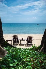Lonely tropical beach with 2 beach chairs