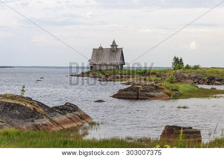 The Coast Of The White Sea Near Rabocheostrovsk, Karelia. An Old Abandoned Russian Wooden Church. Th