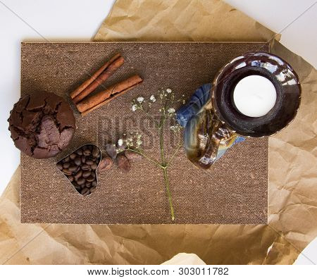 White Candle In Candlestick, Elephant Shape, Branch  Of Flowers, Heart Form Coffee Beans, Chocolate
