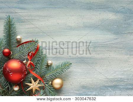 Christmas Background: Corner Decorated With Fir Twigs And Christmas Baubles On Light Neutral Backgro