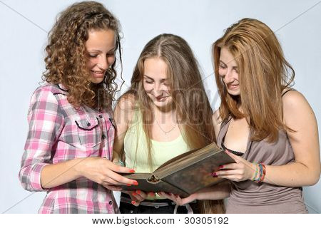 Portrait of smart students girls reading the book