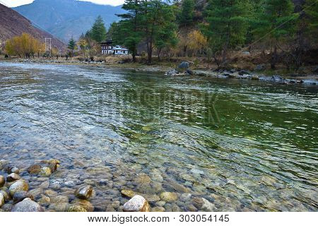 View Of The Densely Packed Dwellings On The Banks Of River Paro Chu In Thimphu, Bhutan. Paro Is The