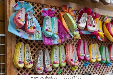 Busan, South Korea - April 2019: Korean Traditional Flower Shoes With Korean Characters, Famous Luck