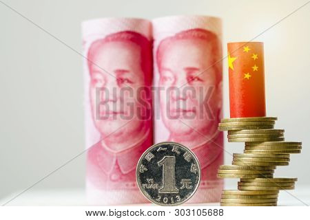 China Yuan Banknote With Coin Stacking And China Flag On White Background.yuan Is Main Exchange Mone