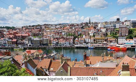 Whitby, England - Aug 2017: View Of Whitby Harbor From High Above.  Shot Taken Near The Abbey And Th