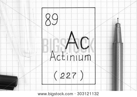 The Periodic table of elements. Handwriting chemical element Actinium Ac with black pen, test tube and pipette. Close-up. poster