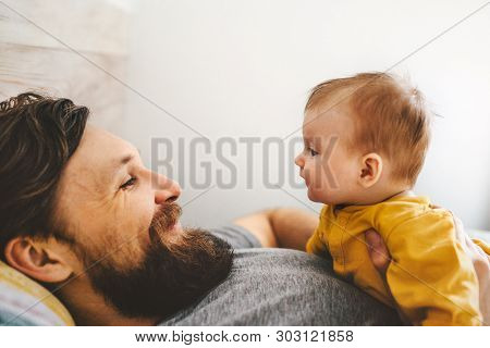 Father And Baby Daughter Playing Together Family Home Lifestyle Dad And Child Parenthood Love Emotio