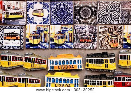 Lisbon, Portugal- March 14, 2019: Colorful Magnet Tram And Tiles Souvenirs Of Lisbon City. Word Lisb