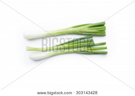 Picture Of Fresh Bunch Of Green Onions Or Scallions Placed On White Background