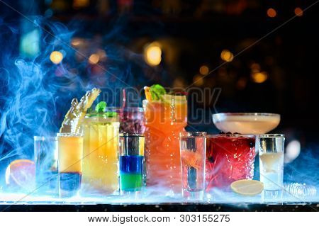 Set Of Classic Cocktails In A Smoke Bar. Alcohol Cocktail In Glass With Ice In Smoke Club Drinks Con