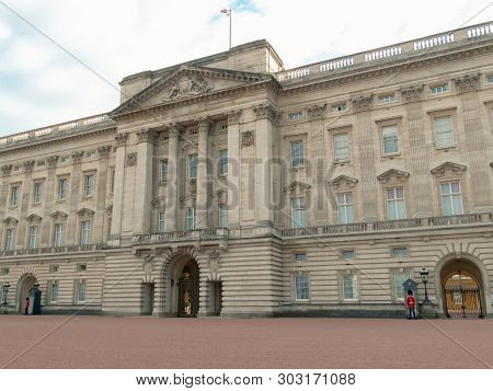 London, Uk - April, 2019: The Queens Guard On Duty At Buckingham Palace, The Official Residence Of T