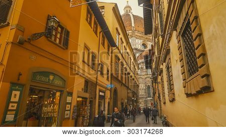 Florence, Italy - November 12th: View Of Florence Cathedral While Looking Down A Narrow Street In Fl