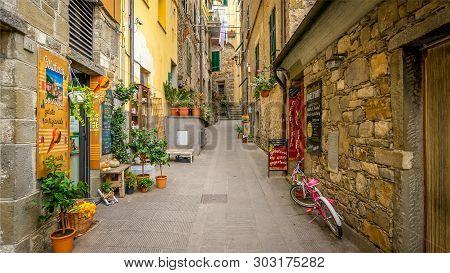 Corniglia, Italy - November 14th: A Narrow Alley With Shops In The Cinque Terre Village Of Corniglia