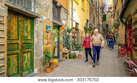 Corniglia, Italy - November 14th: Tourists Walk Along A Narrow Alley In The Cinque Terre Village Of