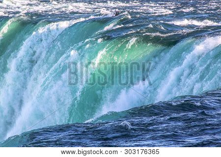 Gorgeous View Of Niagara Falls Landscape.waves Rumbling Against The Rocky Shore. Beautiful Nature Ba