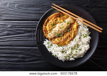 Crispy Fluffy egg Foo young Filled With Crisp Veggies And Aromatic Green Onion And Served With A Ric