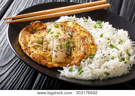 Fried Omelet Mixed With Bean Sprouts And Ground Meat Served With A Side Of White Rice Close-up On A