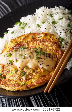 Chinese Omelette Egg Foo Young Served With Rice Close-up. Vertical