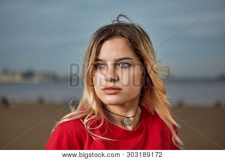 Outdoor Portrait Of Caucasian Ethnicity White Young Adult Woman 20-24 Years Old In Red T-shirt With