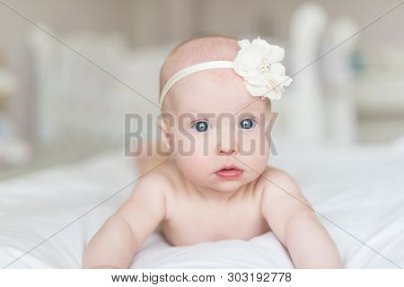 Beautiful Newborn Baby Girl With Blue Eyes.
