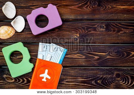 Funny Vocation Concept With Camera, Passport And Tickets On Wooden Background Top View Copy Space