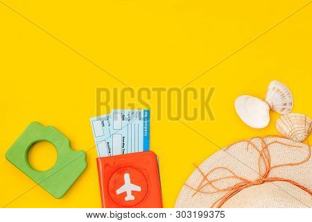 Camera, Hat, Passport And Tickets For Summer Photo At The Seaside On Yellow Background Top View Mock