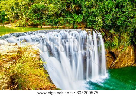 Majestic Shifen Waterfall In Pingxi District Of New Taipei City, Taiwan, On The Upper Reaches Of The