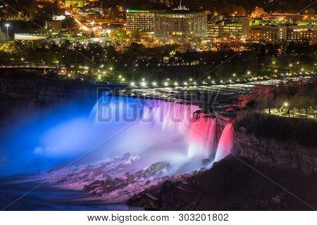Niagara Falls, Canada - May 18-2019. Red, Blue Lights Illuminates The Waterfalls On Niagara Falls.