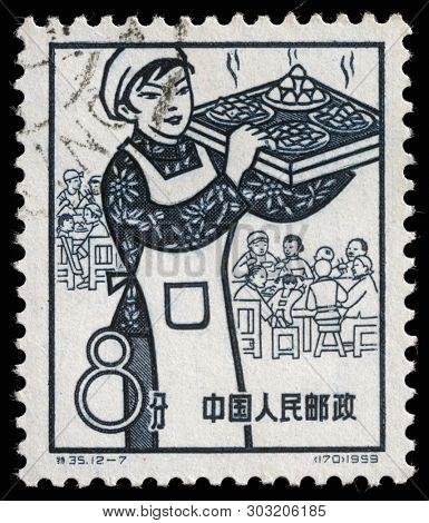 ZAGREB, CROATIA - SEPTEMBER 08, 2014: A stamp issued in the China shows dining, the 1st Anniversary of People's Communes, circa 1959.