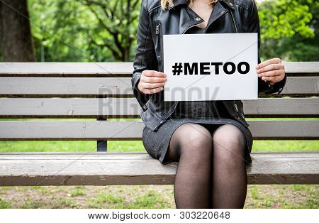 Hashtag For Mee Too Movement Woman Sitting On A Bench At The Park With A Broadsheet Againts Sexual H