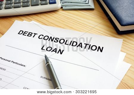 Debt Consolidation Loan Concept. Stack Of Papers In The Office.