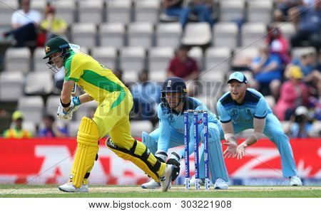 SOUTHAMPTON, ENGLAND. 25 MAY 2019: Steve Smith of Australia plays a shot as Jos Buttler and Ben Stokes of England look on during the England v Australia, ICC Cricket World Cup warm up match,