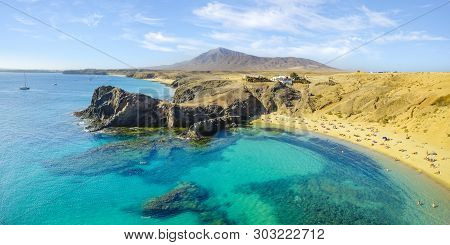Turquoise Ocean Water In The Lagoon At Papagayo Beach In Lanzarote