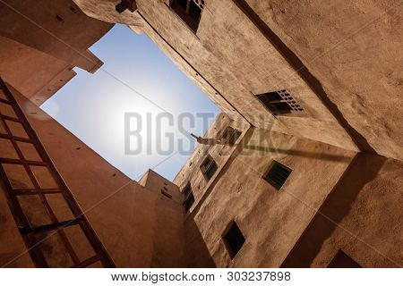 Midday sun above a courtyard in Rustaq Fort in Oman