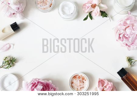 Styled Beauty Frame, Web Banner. Skin Cream, Shampoo, Tonicum Bottles, Leaves, Rose, Peony Flowers A
