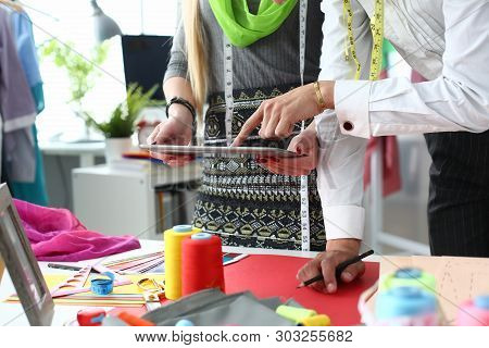 Sewing Technology Needlework Industry Concept. Tailors Team At Workplace With Textile, Needling Tool