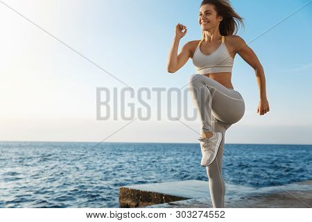 Motivated Happy Sporty Woman Wearing Sports Bra, Sneakers Enjoying Excercise, Training Outdoors Near