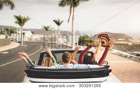 Happy Friends Having Fun In Convertible Car On Vacation - Young Millennial People Driving On Cabriol