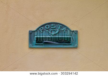 Mailbox In Italy With The Inscription In Italian The Word Posta Means Mail On Yellow Wall Of The Hou