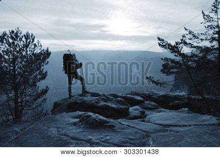Climber With Hiking Backpack Go To The Mountains. Hikers In Mountains. Male Strong Carrier With Back