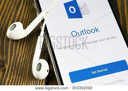 Helsinki, Finland, May 4, 2019: Microsoft Outlook Office Application Icon On Apple Iphone X Screen C