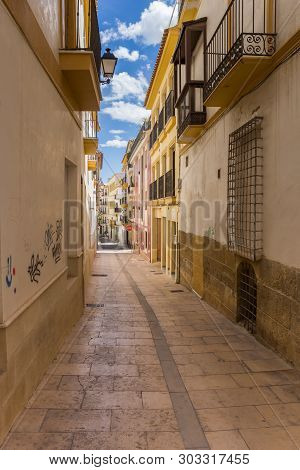 Lorca, Spain - May 09, 2019: Colorful Houses In A Narrow Street In Lorca, Spain