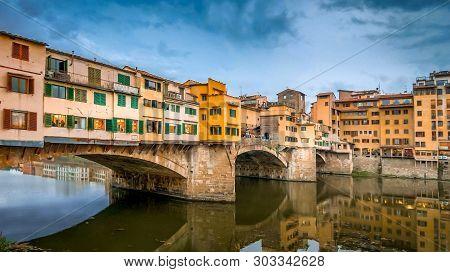 Ponte Vecchio Bridge Spans The Arno River In Florence, Italy