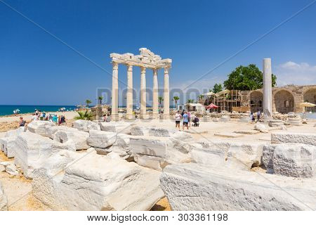 Side, Turkey - June 8, 2018: People at the Temple of Apollo in Side, Turkey. Side  is an ancient Greek city on the southern Mediterranean coast of Turkey.