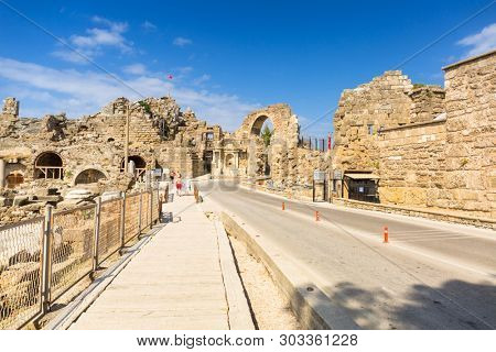 Side, Turkey - June 11, 2018: People on the main road to Side town at sunny day, Turkey. Side  is an ancient Greek city on the southern Mediterranean coast of Turkey.