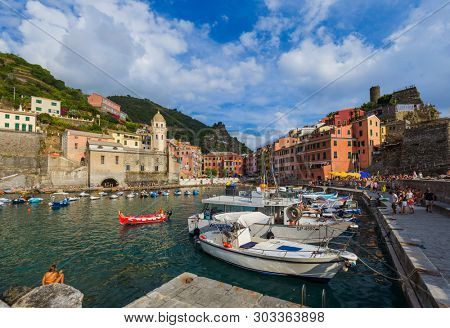 VERNAZZA, ITALY - AUGUST 17, 2016: Tourists walk by Vernazza in Cinque Terre on August 17, 2016 in Vernazza Italy.