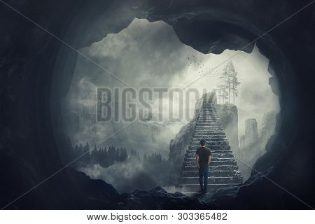 Surreal View As A Man Escape From A Dark Cave Climbing A Mystic Stairway Crossing The Misty Abyss Go