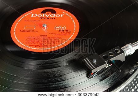London, England - May 08, 2019: Vintage Vinyl Record With Polydor Label Played On Turntable With Aud