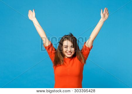 Beautiful Fun Young Woman Wearing Red Orange Dress Fooling Around Fluttering Flying Hair Raised Hand